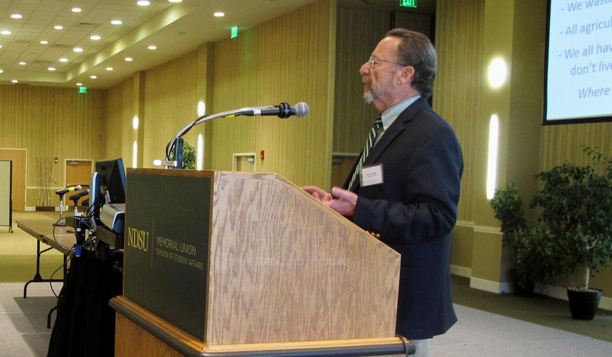 Bruce Chassey, professor emeritus in food safety and nutritional sciences at the University of Illinois, delivers the keynote speech at a biotech conference on the campus of North Dakota State University in Fargo, N.D., on Thursday, May 12, 2016. Chassey told the group that the reason some people are advocating for food labeling is to get genetically modified products off the market. (AP Photo/Dave Kolpack)