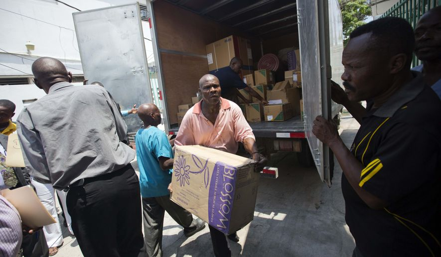 A worker deliver boxes of gloves to the General Hospital in Port-au-Prince, Haiti, Thursday, May 12, 2016. Doctors have refused to take new patients since late March, saying the government isn't providing supplies or compensating them fairly. A truckload of basic medical supplies has been delivered but resident doctors say it's not nearly enough to end their weeks-old strike. (AP Photo/Dieu Nalio Chery)