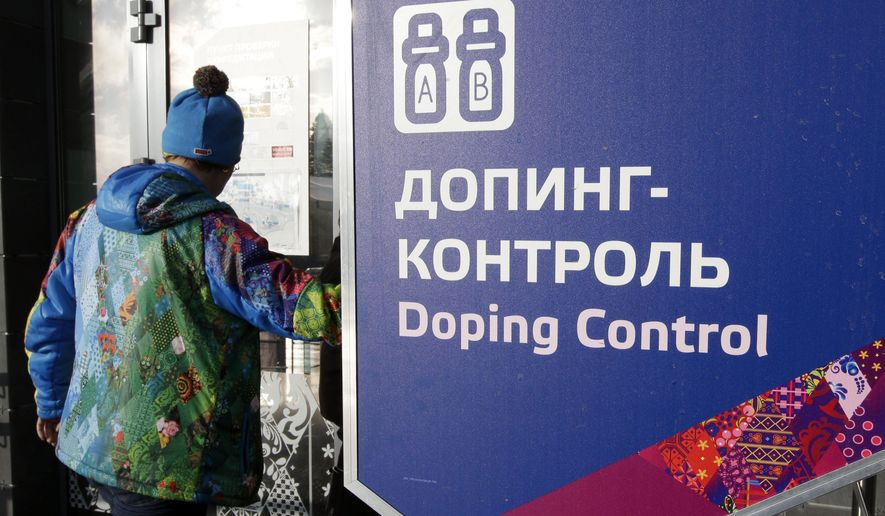 """FILE - In this Feb. 21, 2014, file photo, a man walks past a sign reading doping control, at the Laura biathlon and cross-country ski center, at the 2014 Winter Olympics in Krasnaya Polyana, Russia. The IOC """"would not hesitate"""" to retest drug samples from the 2014 Winter Games in Sochi if there is evidence that doping controls were manipulated, according to the Olympic body's medical director. A Russian whistleblower told CBS' """"60 Minutes"""" that four Russian gold medalists from the Sochi Olympics used steroids and Russian security agents worked as doping control officers during the games. (AP Photo/Lee Jin-man, File)"""