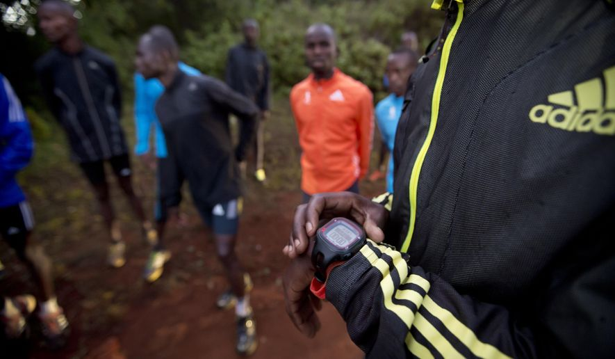 FILE - In this Saturday, Jan. 30, 2016 file photo, an athlete sets the timer on his watch before starting to run with others in Kaptagat Forest in western Kenya. World Anti-Doping Agency (WADA) officials declared Kenya's drug-fighting agency out of compliance Thursday, May 12, 2016, a move that places the track powerhouse's participation in this summer's Olympics in jeopardy. (AP Photo/Ben Curtis, File)