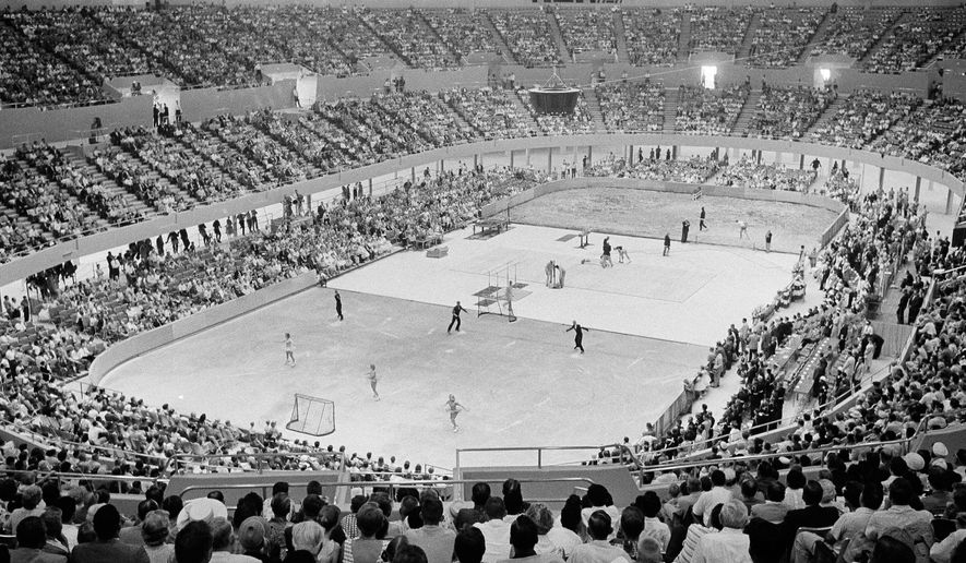 FILE - In this July 4, 1959 file photo, the crowd watches three different sports activities being staged at once at the Los Angeles Memorial Sports Arena in Las Angeles. The crowd was there to hear Vice President Richard M. Nixon deliver the dedication address for arena. The Los Angeles Memorial Sports Arena is about to become just a memory. City leaders are holding a closing ceremony Thursday, May 12, 2016, for the building that hosted to some of the 20th century's biggest moments in sports, politics and rock 'n' roll. (AP Photo/Don Brinn, File)