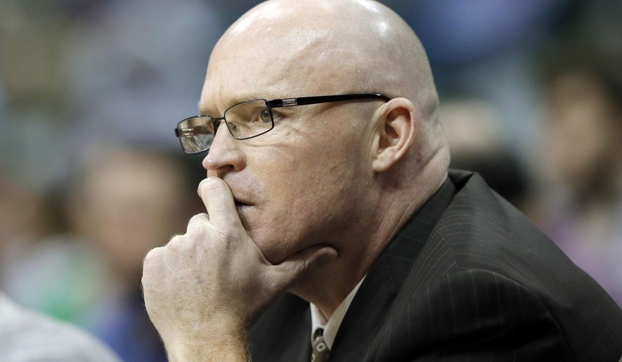 FILE - In this March 1, 2016, file photo, Orlando Magic head coach Scott Skiles watches play late in the second half of an NBA basketball game against the Dallas Mavericks, in Dallas. Skiles has stepped down as coach of the Magic. Skiles was 35-47 this season, his lone year leading the Magic. The team made the surprising announcement Thursday morning, May 12, 2016, saying Skiles informed them that he would not be returning. (AP Photo/Tony Gutierrez, File)