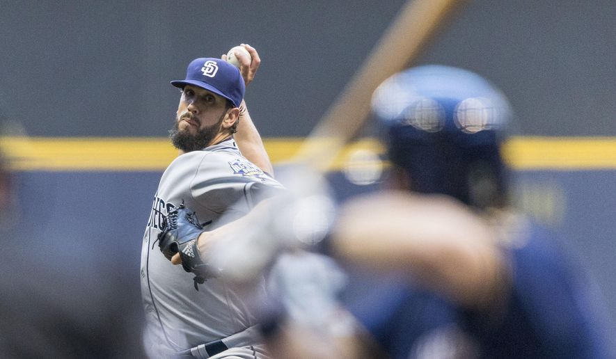 San Diego Padres' James Shields pitches to a Milwaukee Brewers batter during the first inning of a baseball game Thursday, May 12, 2016, in Milwaukee. (AP Photo/Tom Lynn)