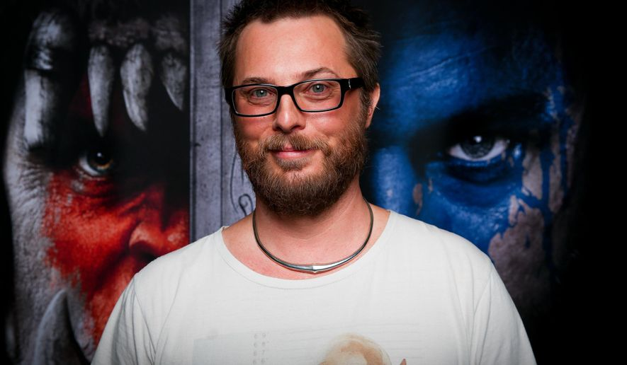 "FILE - In this Nov. 6, 2015 file photo, filmmaker Duncan Jones poses for a portrait during Blizzcon at the Anaheim Convention Center in Anaheim, Calif. Jones directed ""Warcraft,"" an adaptation of the long-running role-playing game, which centers on the conflict between orcs and humans depicted in ""World of Warcraft"" and the original ""Warcraft"" games from the 1990s. The film, starring Travis Fimmel, Dominic Cooper, Ben Foster, Toby Kebbell and Paula Patton, opens June 10. (Photo by Rich Fury/Invision/AP, File)"