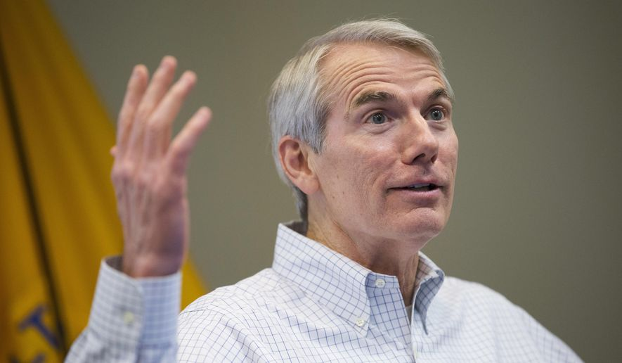 FILE - In this April 1, 2016, file photo,  U.S. Sen. Rob Portman, R-Ohio, discusses efforts to increase health and safety for workers at the National Institute for Occupation Safety and Health (NIOSH) facility, in Cincinnati. Portman is flexing his cash advantage over Democratic challenger Ted Strickland by snapping up prime TV air time now for ads he'll run across Ohio through Election Day. Portman's considered one of the Senate's most vulnerable Republicans this cycle, as he faces the well-known former governor. (AP Photo/John Minchillo, File)