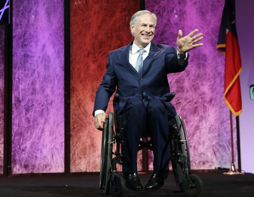 Texas Gov. Greg Abbott waves on stage before speaking during the opening of the Texas Republican Convention Thursday, May 12, 2016, in Dallas. (AP Photo/LM Otero)