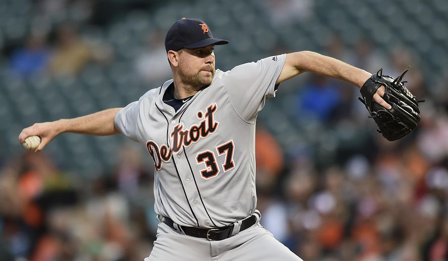 Detroit Tigers pitcher Mike Pelfrey delivers against the Baltimore Orioles in the first inning of a baseball game, Saturday, May 12, 2016, in Baltimore. (AP Photo/Gail Burton)