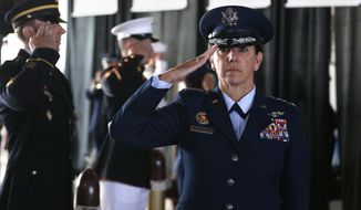 Air Force Gen. Lori J. Robinson, the incoming commander of the North American Aerospace Defense Command and U.S. Northern Command, salutes during her arrival at the change of command ceremony, at Peterson Air Force Base, in Colorado Springs, Colo., Friday, May 13, 2016. Gen. Robinson is the first woman to lead a top-tier U.S. military command after taking charge Friday at NORAD and USNORTHCOM. (AP Photo/Brennan Linsley)