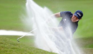Phil Mickelson hits from a sand bunker on the eighth hole during the second round of The Players Championship golf tournament Friday, May 13, 2016, in Ponte Vedra Beach, Fla. (AP Photo/Lynne Sladky)