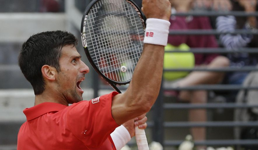 Novak Djokovic, of Serbia, celebrates after winning the first set against Rafael Nadal, of Spain, during their quarter final match at the Italian Open tennis tournament, in Rome, Friday, May 13, 2016. (AP Photo/Alessandra Tarantino)