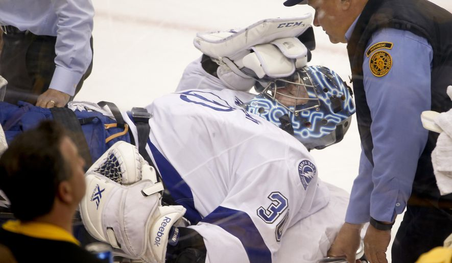 Tampa Bay Lightning goalie Ben Bishop is carted off the ice after being injured during the first period of Game 1 against the Pittsburgh Penguins in the NHL hockey Stanley Cup Eastern Conference finals Friday, May 13, 2016, in Pittsburgh. (AP Photo/Gene J. Puskar)
