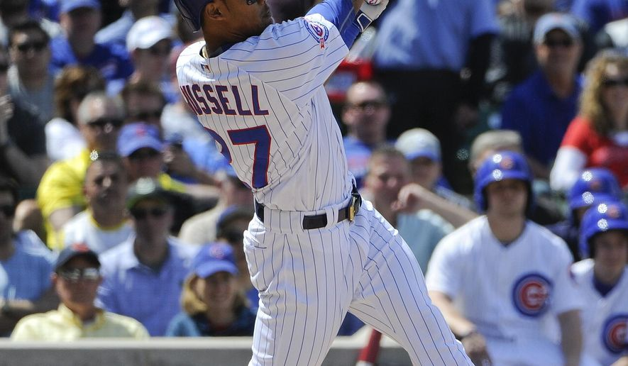 Chicago Cubs' Addison Russell hits a three-run homer in the fourth inning of a baseball game against the Pittsburgh Pirates on Friday, May 13, 2016, in Chicago. (AP Photo/Matt Marton)
