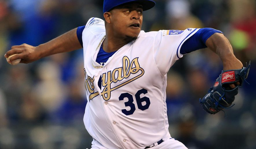 Kansas City Royals starting pitcher Edinson Volquez delivers to an Atlanta Braves batter during the first inning of a baseball game at Kauffman Stadium in Kansas City, Mo., Friday, May 13, 2016. (AP Photo/Orlin Wagner)