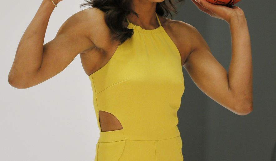 FILE - In this May 5, 2016, file photo, Dallas Wings' Skylar Diggins poses for a photo shoot during the WNBA basketball team's media day, in Arlington, Texas.  The WNBA tips off its 20th season this weekend with the return of some familiar faces and the finale for others. Diggins hopes to pick up where she left off before she was injured last year. She'll be doing it in front of a new fan base as Tulsa moved to Dallas in the offseason. (AP Photo/Tony Gutierrez, File)