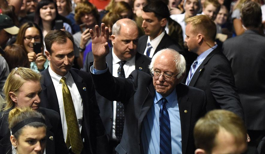 Democratic presidential candidate Bernie Sanders leaves after speaking with supporters at Sioux Falls Convention Center in Sioux Falls, S.D., Thursday, May 12, 2016. (Emily Spartz Weerheim/The Argus Leader via AP) MANDATORY CREDIT