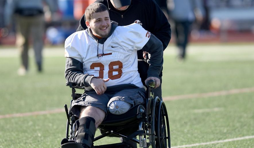 ADVANCED FOR RELEASE SATURDAY, MAY 14, 2016 Waynesburg University football player Kurt Detwiler was injured in a crash on May 23. Detwiler's leg had to be amputated due to his injuries from the crash.  He continues to support the football team from the sidelines. (Katie Roupe/Observer-Reporter via AP)