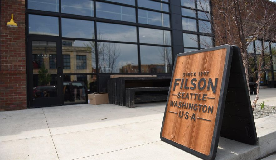 This May 12, 2016 photo shows the outside of Filson, a Seattle-based manufacturer and outfitter, in Detroit.   The Seattle-based outfitter opened its first Michigan store in Detroit's Midtown neighborhood. The Detroit location is Filson's tenth retail store.   (Tanya Moutzalias/MLive Detroit via AP)