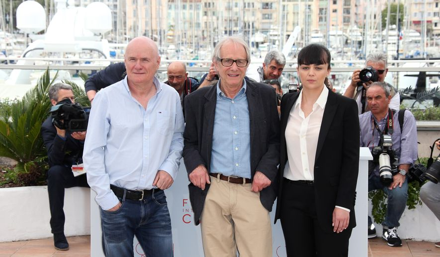 Actor Dave Johns, director Ken Loach and actress Hayley Squires, from left, pose for photographers, during a photo call for the film I, Daniel Blake at the 69th international film festival, Cannes, southern France, Friday, May 13, 2016. (AP Photo/Joel Ryan)