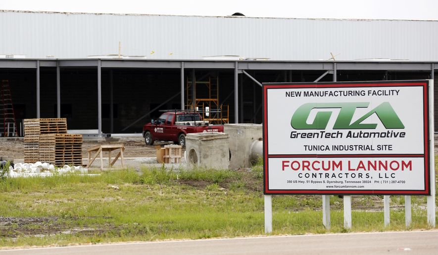 In this May 13, 2014 photo, supplies sit at the GreenTech Automotive's plant in Tunica, Miss. GreenTech Automotive is renegotiating its incentive deal with the state of Mississippi after state officials say the electric-vehicle maker failed to meet its 350-job employment target at its Tunica County, Miss., plant. (AP Photo/Rogelio V. Solis, File)