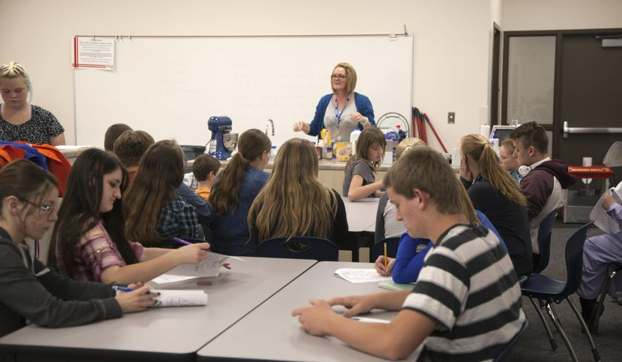 In this Wednesday, May 11, 2016 photo, Water Canyon High School students receive home economics instruction, in Hildale, Utah. The school in a polygamous community on the Utah-Arizona border that reopened two years ago unveiled a new building for high school students as the rebirth of the public education system in the town sets more roots.  (Chris Caldwell /The Spectrum via AP) NO SALES; MANDATORY CREDIT