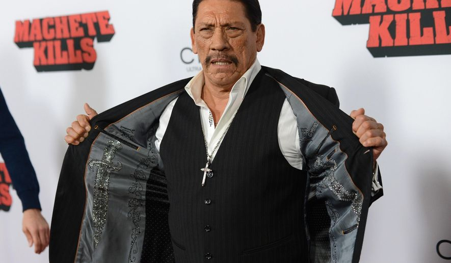 """FILE - In this Oct. 2, 2013, file photo, actor Danny Trejo arrives at the premiere of """"Machete Kills"""" at Regal Cinemas L.A. Live in Los Angeles. The Los Angeles Times reports Trejo took the floor at a community meeting at Sylmar High School in Los Angeles on May 11, 2016, following a brawl at the school. (Photo by Jordan Strauss/Invision/AP, File)"""
