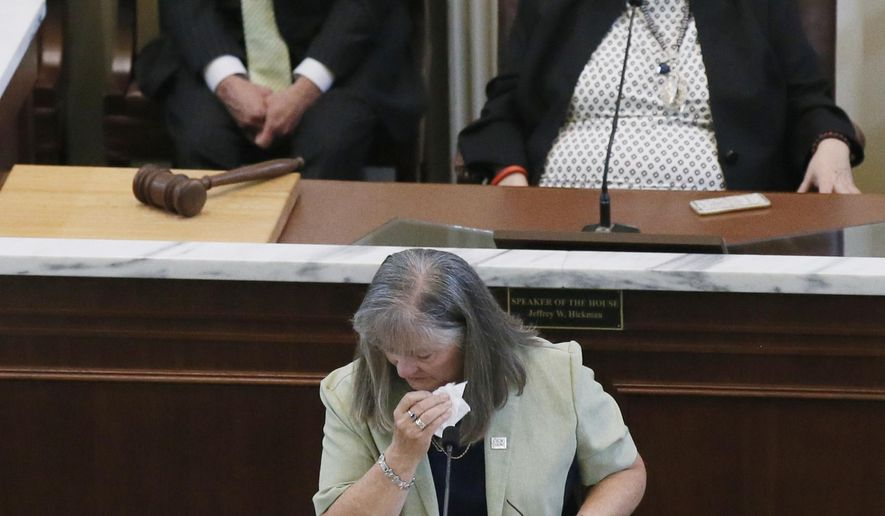 Oklahoma state Rep. Sally Kern, R-Oklahoma City, a term-limited legislator, wipes a tear away as she gives a farewell speech on the floor of the House in Oklahoma City, Wednesday, May 11, 2016. Kern drew national attention in 2008 when she said the homosexual agenda was a greater threat to America than terrorism. (AP Photo/Sue Ogrocki)