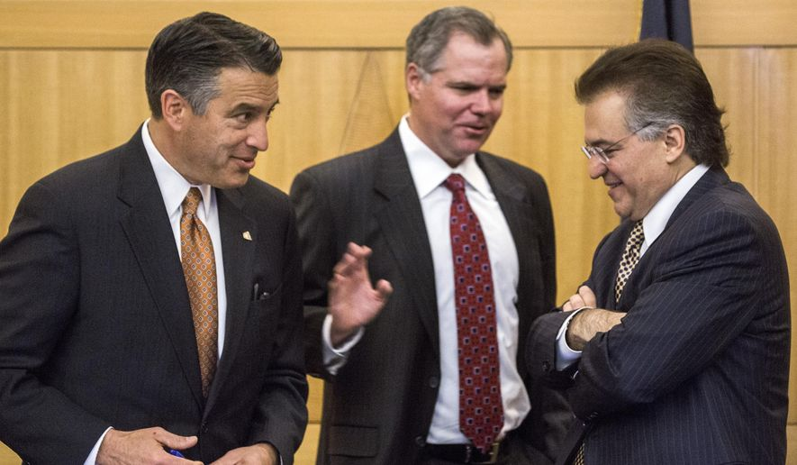 """Nevada Gov. Brian Sandoval, from left, Bill Murren, CEO of MGM Resorts International, and Tony Alamo, chairman of Nevada Gaming Commission, talk during the Gaming Policy Committee meeting to discuss """"esports"""" in Las Vegas on Friday, May 13, 2016. (Jeff Scheid/Las Vegas Review-Journal via AP) MANDATORY CREDIT"""