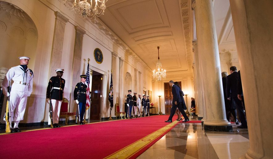 President Barack Obama leaves the Grand Foyer of the White House in Washington, Friday, May 13, 2016, following the arrival ceremony for the Nordic summit. Nordic leaders are at the White house for a U.S.-Nordic Summit on security and economic issues followed by a State Dinner. (AP Photo/Andrew Harnik)