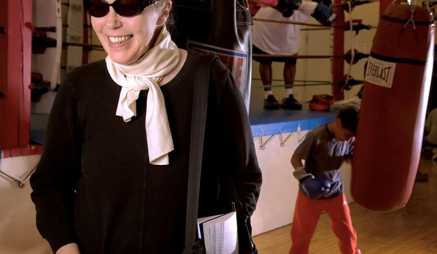 """In this 2009 photo, journalist and author, Katherine Dunn, makes a visit to one of boxing news sources at the Matt Dishman Community Center & Pool boxing gym, in Portland, Ore. Her boxing coverage was collected into an anthology in 2009 called """"One Ring Circus: Dispatches from the World of Boxing."""" Dunn, who was famous for her novel """"Geek Love,"""" died at age 70 on Wednesday, May 11, 2016, at her home in Portland, Ore. Dunn died of complications from lung cancer, The Oregonian/OregonLive reported.  (Thomas Boyd/The Oregonian via AP) MAGS OUT; TV OUT; NO LOCAL INTERNET; THE MERCURY OUT; WILLAMETTE WEEK OUT; PAMPLIN MEDIA GROUP OUT; MANDATORY CREDIT"""