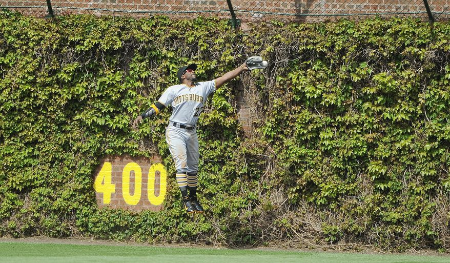 Pittsburgh Pirates center fielder Andrew McCutchen (22) leaps but cannot catch a ball hit by Chicago Cubs Anthony Rizzo in the fifth inning of a baseball game on Friday, May 13, 2016, in Chicago. (AP Photo/Matt Marton)