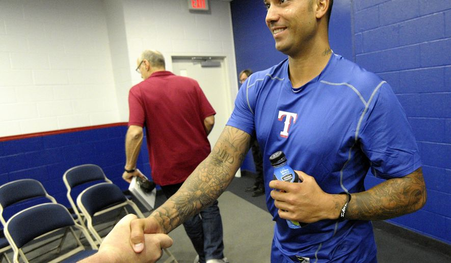 Texas Rangers Matt Bush shakes hands after a news conference before a baseball game against the Toronto Blue Jays, Friday, May 13, 2016 in Arlington, Texas.  The Texas Rangers promoted hard-throwing reliever Matt Bush from Double-A Frisco on Friday, making him available for his major league debut seven months after getting out of prison and 12 years after being the No. 1 overall pick. (Max Faulkner/Star-Telegram via AP)  MAGS OUT; (FORT WORTH WEEKLY, 360 WEST); INTERNET OUT; MANDATORY CREDIT