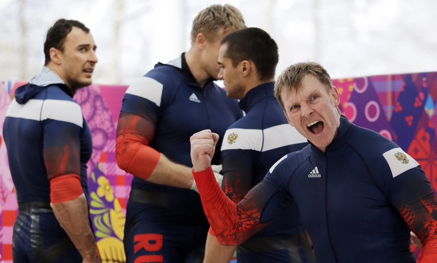FILE - In this Sunday, Feb. 23, 2014 file photo, the team from Russia RUS-1 with Alexander Zubkov, foreground, Alexey Negodaylo, Dmitry Trunenkov, and Alexey Voevoda, react after their third run during the men's four-man bobsled competition final at the 2014 Winter Olympics, in Krasnaya Polyana, Russia. Two Olympic gold medallists deny doping after they were named in a New York Times report as having been on a list of doped athletes allegedly compiled by the Russian Sports Ministry. Bobsledder Alexander Zubkov told the state TV that he was clean during the Sochi Olympics.  (AP Photo/Jae C. Hong, File)