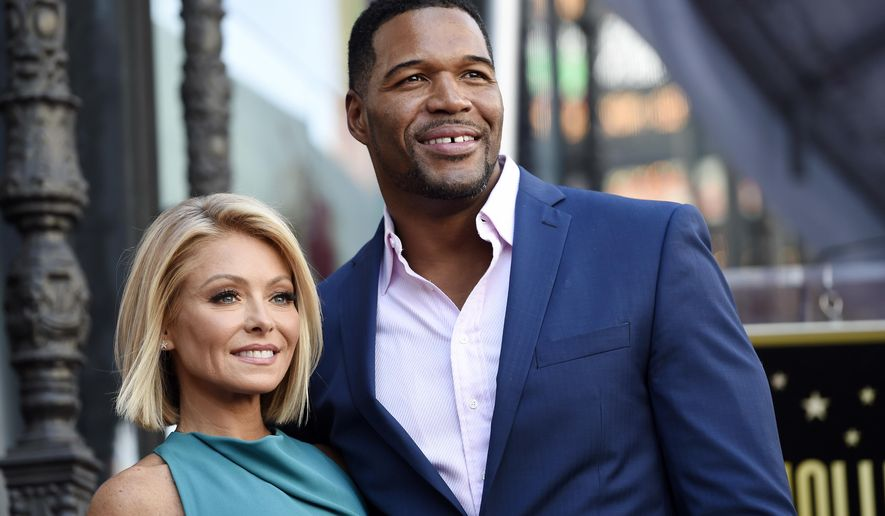 "FILE - In this Oct. 12, 2015 file photo, Kelly Ripa, left, poses with Michael Strahan, her co-host on the daily television talk show ""LIVE! with Kelly and Michael,"" during a ceremony honoring Ripa with a star on the Hollywood Walk of Fame in Los Angeles. Strahan says goodbye to his daytime talk show with Kelly Ripa on Friday,  May 13, 2016, an exit accelerated by awkwardness surrounding the announcement of his new job at ""Good Morning America."" (Photo by Chris Pizzello/Invision/AP, File)"