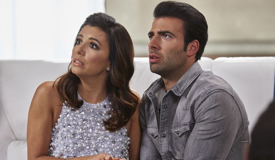 "This image released by NBC shows Eva Longoria as Ana Sofia Calderon, left, and Jencarlos Canela as Xavier Castillo in a scene from the NBC comedy series, ""Telenovela."" NBC canceled the comedy spoof of the Spanish-language soap operas, Friday, May 13, 2016, after only a few months on the air. (Ben Cohen/NBC via AP)"