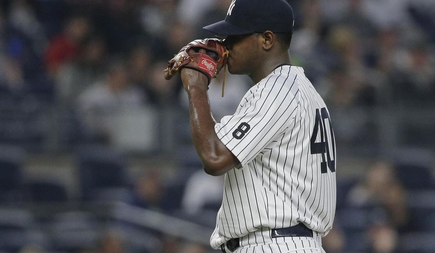 New York Yankees pitcher Luis Severino reacts after giving up a two-run home run to Chicago White Sox's Jimmy Rollins during the third inning of a baseball game Friday, May 13, 2016, in, New York. (AP Photo/Julie Jacobson)