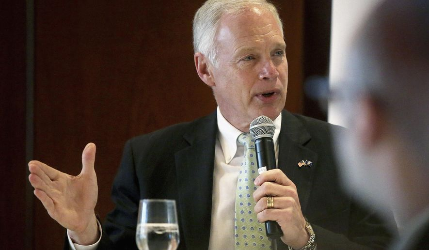 FILE - In this Oct. 9, 2015 file photo, U.S. Sen. Ron Johnson, R-Wis., speaks at a luncheon in Madison, Wis. Wisconsin Republicans struggling with accepting Donald Trump as the party's presidential nominee gather for the annual state convention in Green Bay beginning Friday, May 13, 2016. Johnson is among the officials who are slated to speak at the convention. (John Hart/Wisconsin State Journal via AP, File) MANDATORY CREDIT