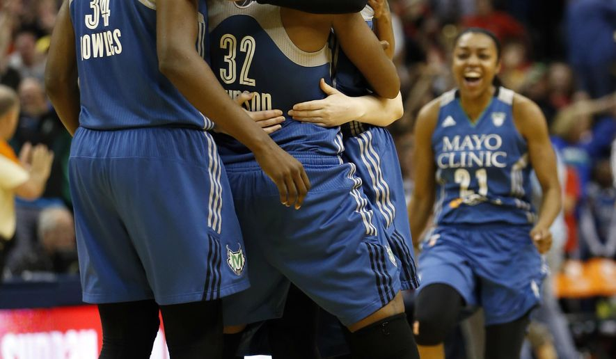 FILE - In this Oct. 9, 2015, file photo, Minnesota Lynx forward Maya Moore, smiling third from left,  celebrates with her teammates after scoring a game winning three-pointer in the second half of Game 3 of the WNBA Finals basketball series against the Indiana Fever, in Indianapolis. The Minnesota Lynx sit atop the first Associated Press WNBA poll. The defending champions received 10 first-place votes from the national media panel on Friday, May 13, 2016. (AP Photo/AJ Mast, File)