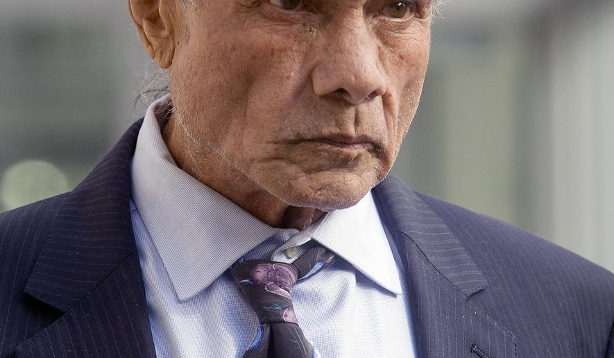 "FILE - In this Nov. 2, 2015 file photo, former professional wrestler Jimmy ""Superfly"" Snuka, right, leaves the Lehigh County Courthouse in Allentown, Pa. A Pennsylvania judge is set to hear testimony Friday, May 13, 2016, on whether Snuka is mentally competent to stand trial in the death of his mistress more than three decades ago. Snuka is charged with third-degree murder and involuntary manslaughter in the 1983 death of 23-year-old Nancy Argentino of New York.  (Michael Kubel/The Morning Call via AP, File) THE EXPRESS-TIMES OUT; WFMZ OUT; MANDATORY CREDIT"
