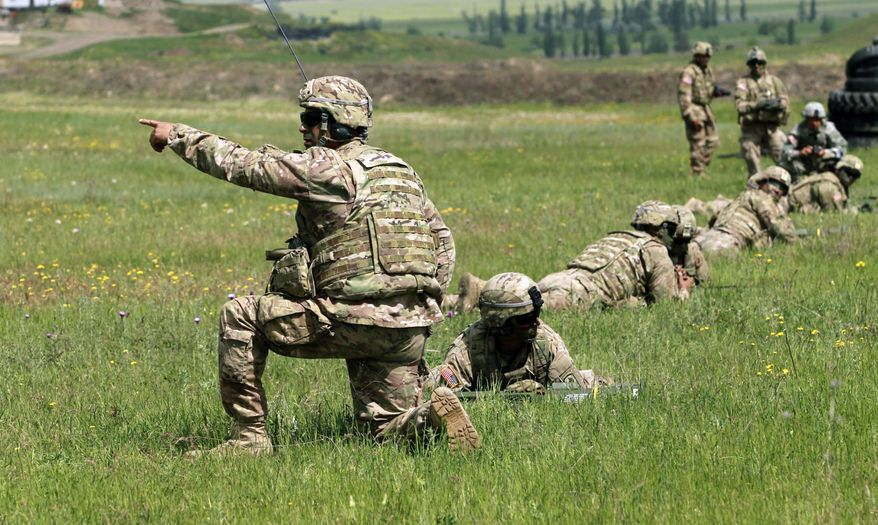U.S. servicemen prepare to fire AT4 light anti-armour weapon during joint military exercises at the Vaziani military base outside Tbilisi, Georgia, Saturday, May 14, 2016. About 1,300 U.S., British and Georgian troops started this week conducting joint exercises aimed at training the former Soviet republic's military for participation in the NATO Response Force. (AP Photo/Shakh Aivazov)