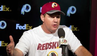 Washington Redskins head coach Jay Gruden speaks during a news conference after the team's NFL football rookie minicamp Saturday, May 14, 2016, in Ashburn, Va. (AP Photo/Jose Luis Magana) **FILE**