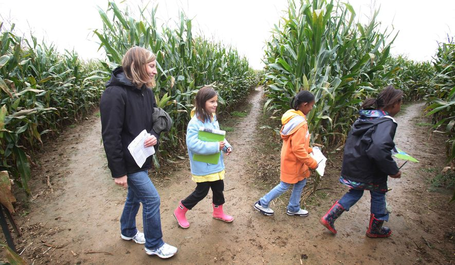 This Sept. 30, 2009 file photo, Amy Wayt, left, leads her daughter Katie, second from left, Niad Clark, second from right and Leah Hall, fourth graders with the Miller South School for the Visual and Performing Arts in Akron as they trek through the Ohio corn maze filling out their Ohio fact-finding paper at the Ramseyer Farm near Wooster, Ohio. Ohio farmers who run petting zoos and corn mazes soon may be protected from being sued if a visitor trips in a field or is bitten by a goat. State lawmakers have signed off on legislation that shields farmers with agritourism businesses from some but not all lawsuits. (John Kuntz, The Plain Dealer via AP, File)  MANDATORY CREDIT    NO SALES
