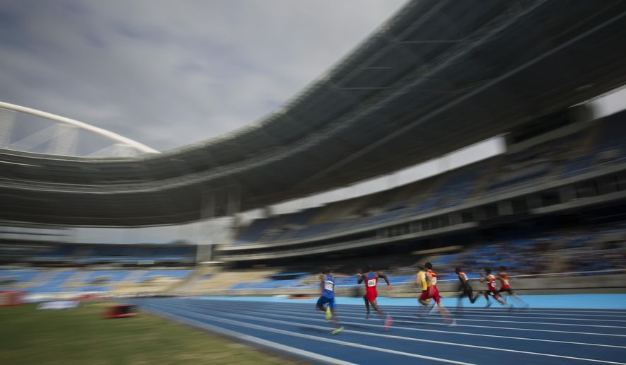 Men compete in the 100m round 1 during the Athletics test event at the Rio Olympic Stadium in Rio de Janeiro, Brazil, Saturday, May 14, 2016. The track and field test event is the last of more than 40 tests events for the Rio de Janeiro Olympics with the games opening in less than three months. The three-day test event ends Monday at Olympic Stadium in the northern neighborhood known as Engenho de Dentro. (AP Photo/Felipe Dana)