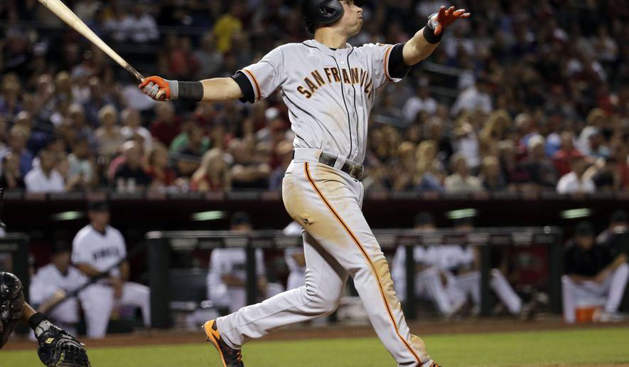 San Francisco Giants' Joe Panik watches his three-run home run take flight against the Arizona Diamondbacks during the sixth inning of a baseball game, Friday, May 13, 2016, in Phoenix. (AP Photo/Matt York)