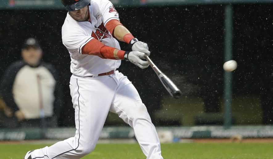 Cleveland Indians' Yan Gomes hits a solo home run off Minnesota Twins relief pitcher Kevin Jepsen in the ninth inning of a baseball game in the rain, Saturday, May 14, 2016, in Cleveland. (AP Photo/Tony Dejak)