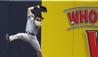 Chicago White Sox right fielder Adam Eaton (1) misjudges a ball hit by New York Yankees' Aaron Hicks for an RBI double during the second inning of a baseball game Saturday, May 14, 2016, in New York. (AP Photo/Frank Franklin II)