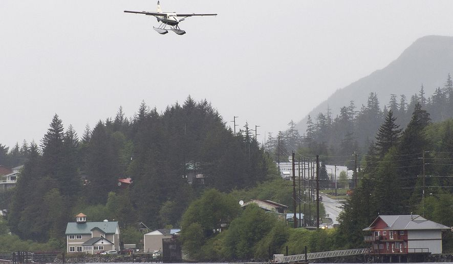 ADVANCE FOR WEEKEND MAY 14-15, 2016 AND THEREAFTER In this May 6, 2016 photo, a de Havilland Otter comes in to land in the Tongass Narrows near the Ketchikan International Airport in Ketchikan, Alaska. Birds and airplanes frequently collide by accident over Alaska, the result of an uneasy timeshare arrangement between species that is costing airlines millions of dollars in the state. (Taylor Balkom/Ketchikan Daily News via AP)