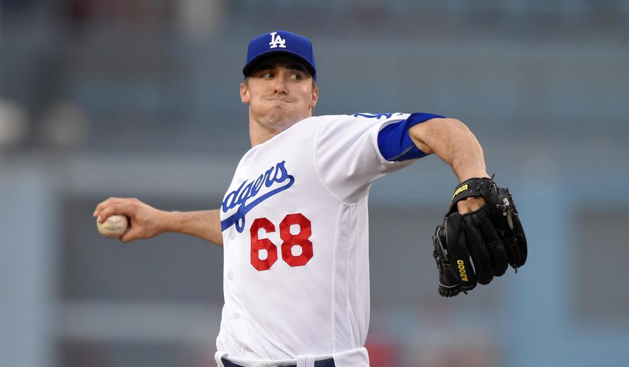 Los Angeles Dodgers starting pitcher Ross Stripling throws to the plate during the first inning of a baseball game against the St. Louis Cardinals, Friday, May 13, 2016, in Los Angeles. (AP Photo/Mark J. Terrill)