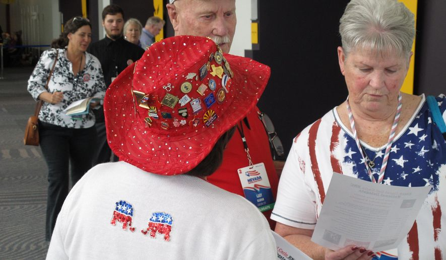 Carol Del Carlo, a Washoe County delegate from Incline Village with her back to the camera, talks with Carson City delegates Gary Beaman and Vicki Graham at the Nevada Republican State Convention in Reno, Nev., on Saturday, May 14, 2016, where Del Carlo she was trying to get elected as an at-large delegate to the national convention this summer in Cleveland, Ohio. (AP Photo/Scott Sonner)