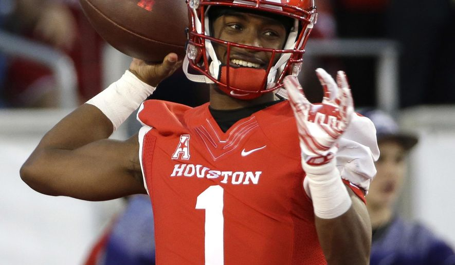 FILe - In this Nov. 14, 2015, file photo, Houston quarterback Greg Ward Jr. (1) warms up before an NCAA college football game against Memphis, in Houston. Cougars coach Tom Herman says Ward must become a more vocal and assertive leader for Houston to match last year's success. (AP Photo/David J. Phillip, File)