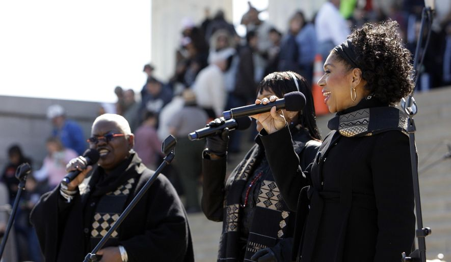 FILE - In this April 12, 2009 file photo, Sweet Honey in the Rock performs during an event to commemorate Marian Anderson's performance 70 years ago, at the Lincoln Memorial in Washington. The a cappella group is planning to protest North Carolina's law addressing LGBT rights and bathroom use by transgender people during their concerts in the state next week. The group announced this week that they will perform as scheduled but protest in song at the Paramount Theatre in Goldsboro, N.C., on May 13, 2016 and at the High Point Theatre in High Point, N.C., on May 14.  (AP Photo/Alex Brandon)